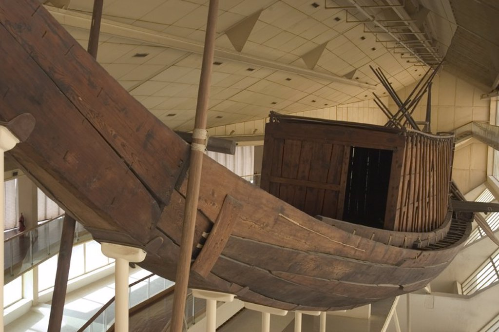 Stock Photo: 4409-60335 Egyptian art. Old Kingdom. IV Dynasty. The Khufu ship. It was sealed into a pit in the Giza pyramid complex at the foot of the Great Pyramid of Giza around 2500 BC. Built of cedar wood in order to transport the pharaoh to the afterlife. The Khufu Boat Museum. Giza.