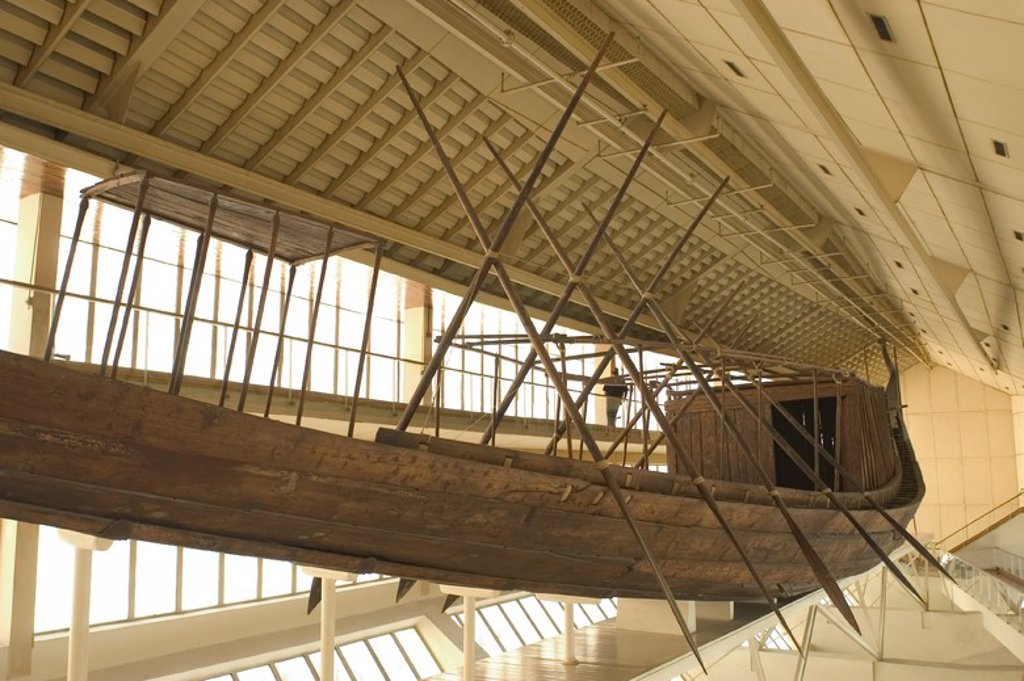 Egyptian art. Old Kingdom. IV Dynasty. The Khufu ship. It was sealed into a pit in the Giza pyramid complex at the foot of the Great Pyramid of Giza around 2500 BC. Built of cedar wood in order to transport the pharaoh to the afterlife. The Khufu Boat Museum. Giza. : Stock Photo