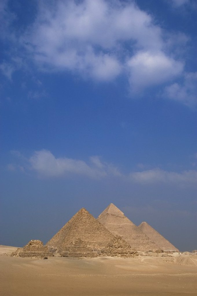 Stock Photo: 4409-60365 Egypt. The Pyramids of Giza. Great Pyramid of Giza (known as the Great Pyramid and the Pyramid of Cheops or Khufu), the Pyramid of Khafre (or Chephren) and the Pyramid of Menkaure (or Mykerinos). 26th century B.C. 4th Dynasty. Old Kingdom.