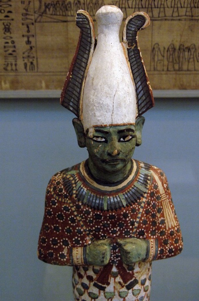 Stock Photo: 4409-61020 Painted wooden statuette of Osiris depicted as a blindfolded man, wearing crown and royal scepters in their hands. Contains the rolled Book of the Dead papyrus of a lady Anhai. 1170 BC. 20th Dynasty. New Kingdom. From the Tomb of Anhai, Akhmin, Egypt. British Museum. London. United Kingdom.