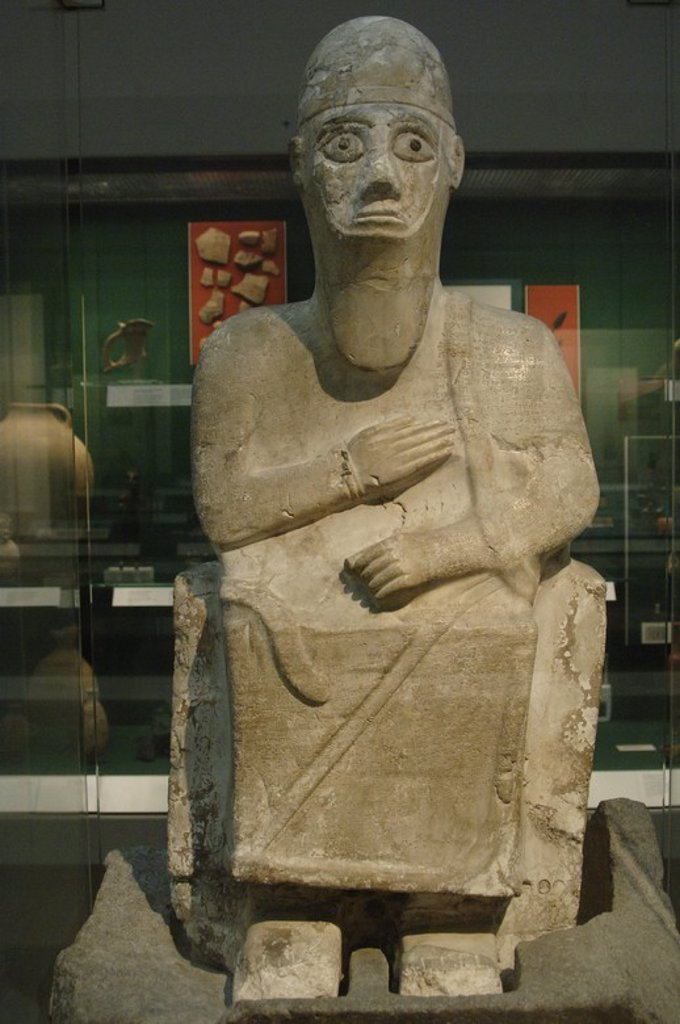 Stock Photo: 4409-61021 Stone statue of King Idrimi of Alalakh seated in his throne. 1570-1500 BC. British Museum. London. United Kingdom.