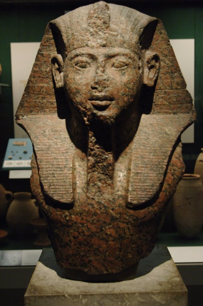 Bust of Pharaoh, possibly Ramses II. Dated c. 1250 BC. Red granite. New Kingdom. 19th Dynasty. British Museum. London. United Kingdom. : Stock Photo