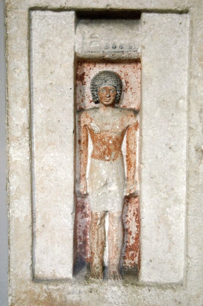 Stock Photo: 4409-61215 Limestone false door of Bateti. The figure inside the niche depicts the deceased out of his grave to receive their offerings. 2400 BC. 5th Dynasty. Old Kingdom. British Museum. London. United Kingdom.