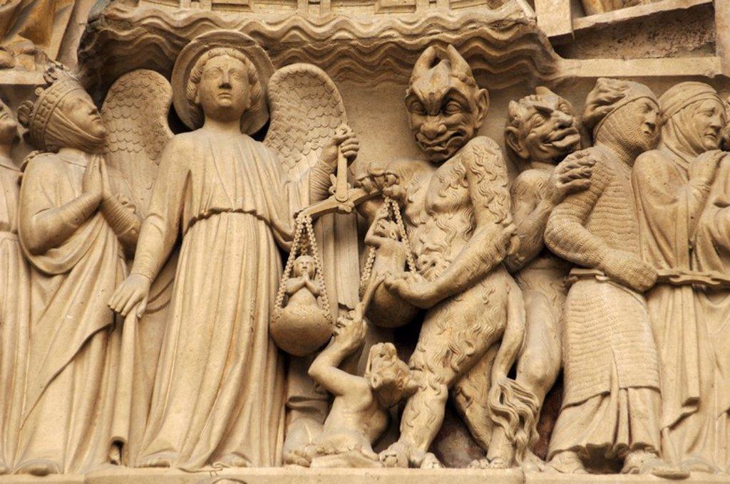 Gothic Art. France. Paris. Notre Dame. Sculptures decorating the portal of the Last Judgment. It was built in the 1220s-1230s. Facade. The archangel Michael is weighing their souls with a furry Devil's interference. Paris. : Stock Photo