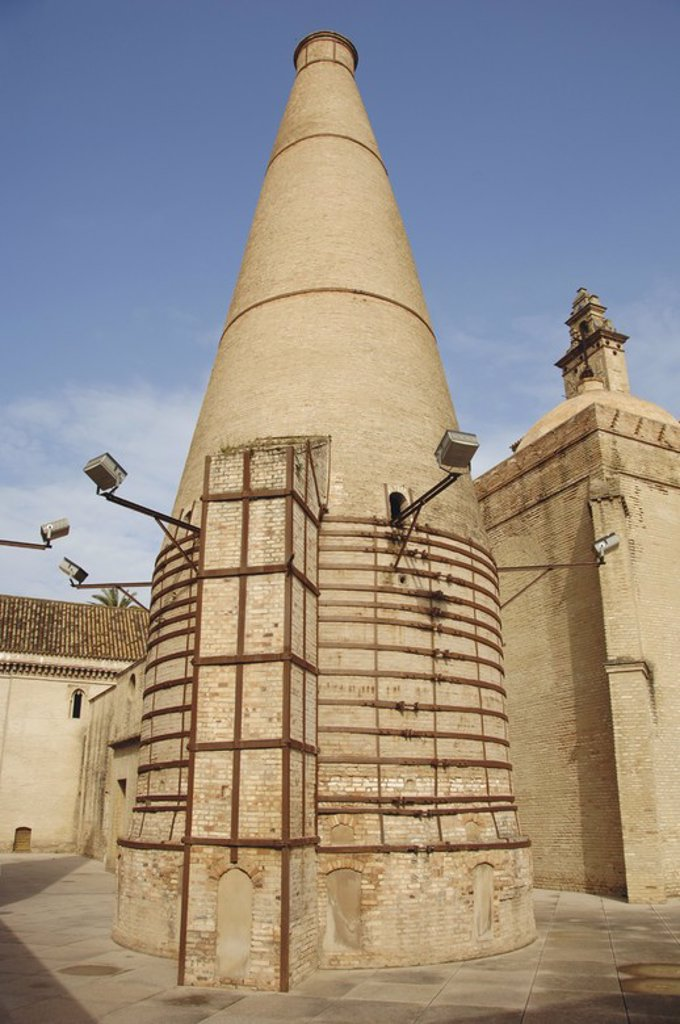 Stock Photo: 4409-61392 Spain. Andalusia. Sevilla. Isla de la Cartuja. Chimneys of the ceramic tile factory installed in the Monastry of Our Lady of the Caves  (Monastery of The Cartuja). Acquired by Charles Pickman in 1839, it became a factory of ceramic and porcelain in 1849.
