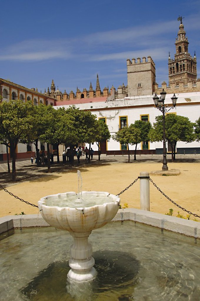 Spain. Andalusia. Seville.  Royal Alcazars of Seville (Real Alcazar). Courtyard of flags. Its present appearance is due to remodeling because of the Latin American Exhibition of 1929. The source, hexagonal, was built in 1928 by Jose Diaz Lafita. : Stock Photo
