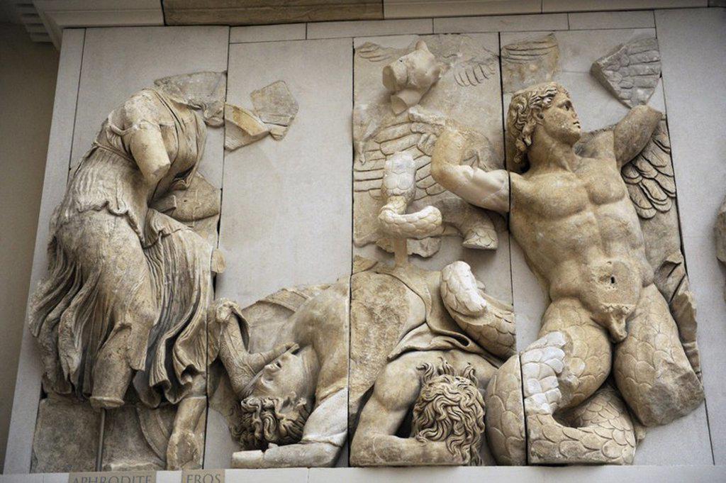 """Stock Photo: 4409-62280 ARTE GRIEGO-HELENISTICO. ASIA MENOR. """"ALTAR DE ZEUS O ALTAR DE PERGAMO"""". Mármol y piedra caliza. Fue construído por orden de Eumenes II Sóter (197-159 a. C.), entre los años 164 y 156 a. C. Los relieves fueron realizados por artistas de la escuela de Pérgamo, en estilo barroco helénico. GIGANTOMAQUIA: FRISO NORTE. """"Afrodia con Eros y gigantes muertos en la batalla"""". Museo de Pérgamo (Isla de los Museos). Berlín. Alemania. Europa."""
