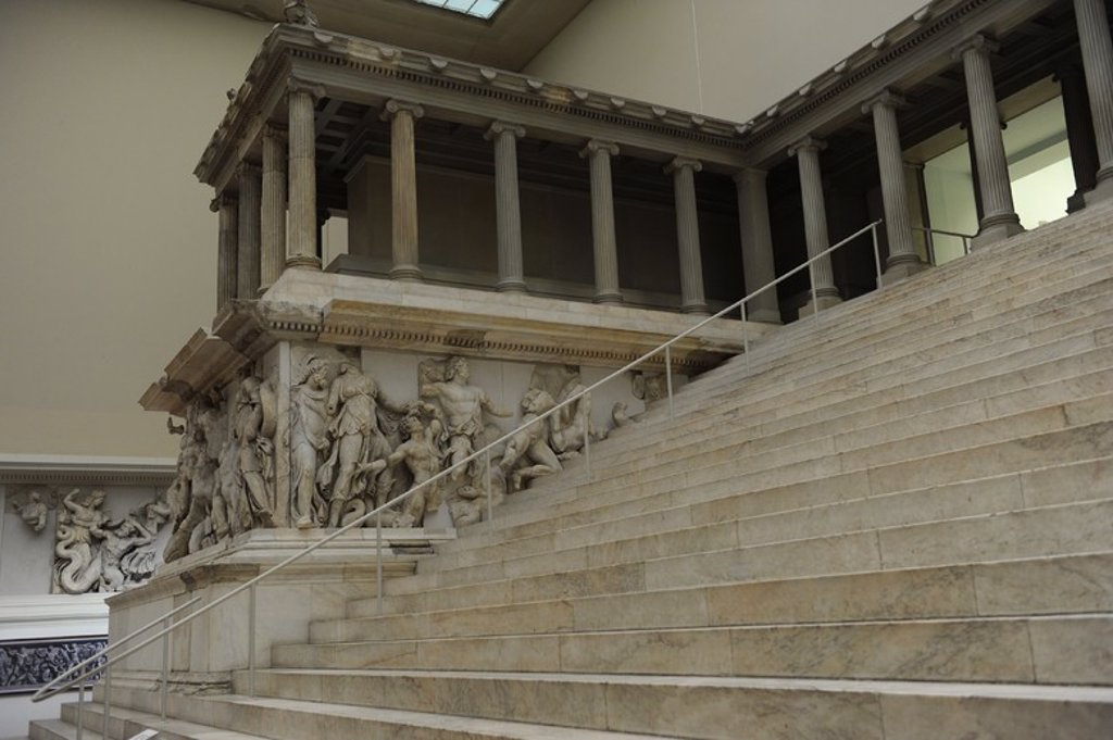 Pergamon Altar. Built by order of Eumenes II Soter. 164-156 BC by artists of the school of Pergamon. Marble and limestone. Gigantomachy. West frieze. Left to right: Nereus, Doris, giant, Oceanus and Thetys. Pergamon Museum. Berlin. Germany. : Stock Photo