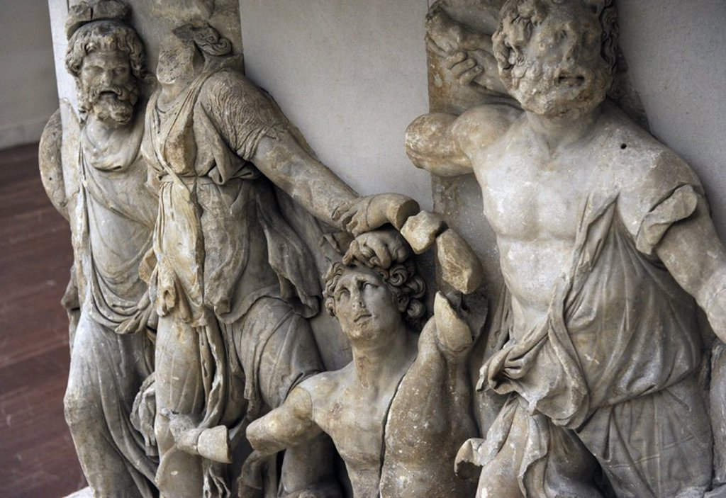 Pergamon Altar. Built by order of Eumenes II Soter. 164-156 BC by artists of the school of Pergamon. Marble and limestone. Gigantomachy. West frieze. Detail. Left to right: Nereus, Doris, giant and Oceanus. Pergamon Museum. Berlin. Germany. : Stock Photo