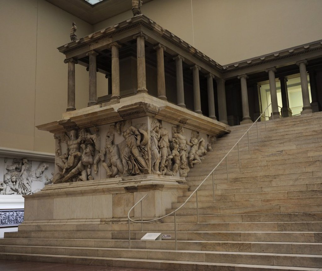Stock Photo: 4409-62408 Pergamon Altar. Built by order of Eumenes II Soter. 164-156 BC by artists of the school of Pergamon. Marble and limestone. Gigantomachy. West frieze. Left to right: Amphitrite and his son Triton fighting the giants. Nereus, Doris, giant, Oceanus, and Thetis. Pergamon Museum. Berlin. Germany.
