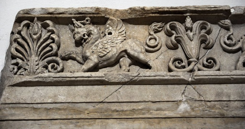 Sanctuary of Athena. 2nd century BC. Fragment of the frieze depicting a griffin. Acropolis of Pergamum. Pergamon Museum. Berlin. Germany. : Stock Photo