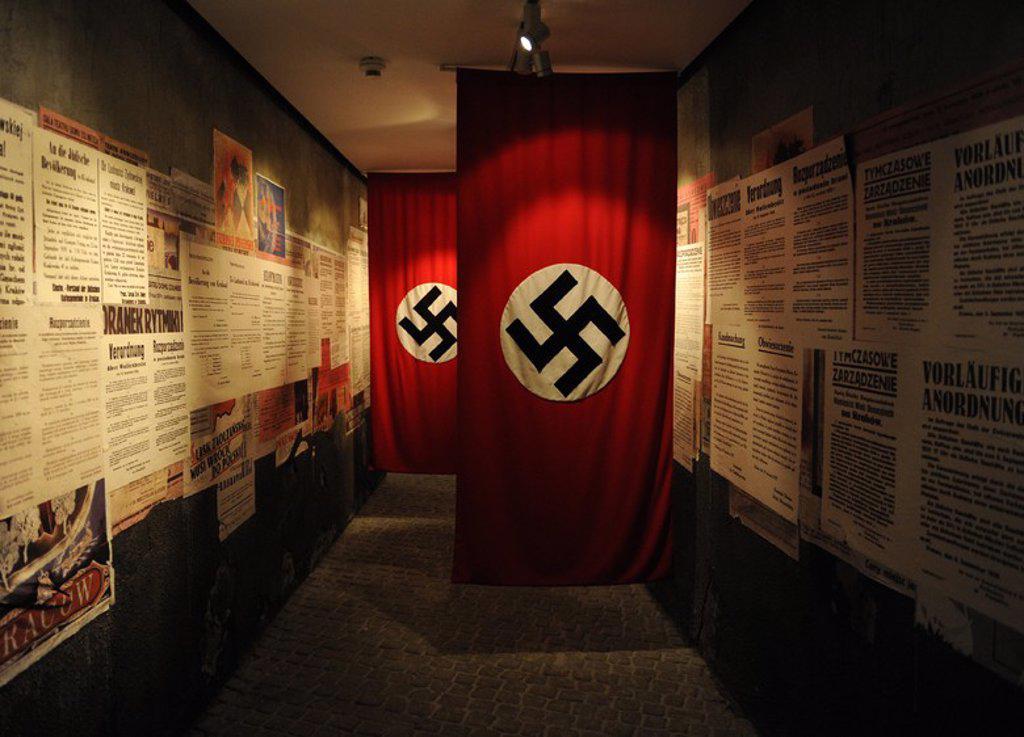 Stock Photo: 4409-62832 MUSEO DE LA FABRICA DE OSCAR SCHINDLER. BANDERAS DE LA ALEMANIA NAZI (1933-1945). Originalmente utilizada como estandarte del Partido Nacional Obrero Alemán. A partir de 1933 con la llegada de Hitler al poder como canciller, se convirtió en la bandera cooficianl junto la bandera del antiguo imperio alemán. Cracovia. Polonia. Europa.