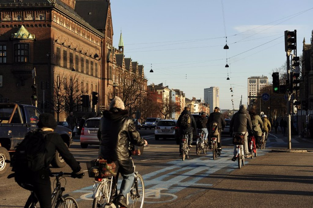 Denmark. Copenhagen. Cyclists circulating by a bike lane. : Stock Photo