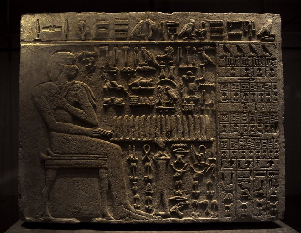 Stock Photo: 4409-64491 The official Isi at his offering Table. From the tomb of Isi Probably at Sakkara. Limestone. 4th Dynastry, c. 2570-2450 BC. Old Kingdom. Reliefs. Detail. Hieroglyphs. Ny Carlsberg Glyptotek. Copenhagen. Denmark.