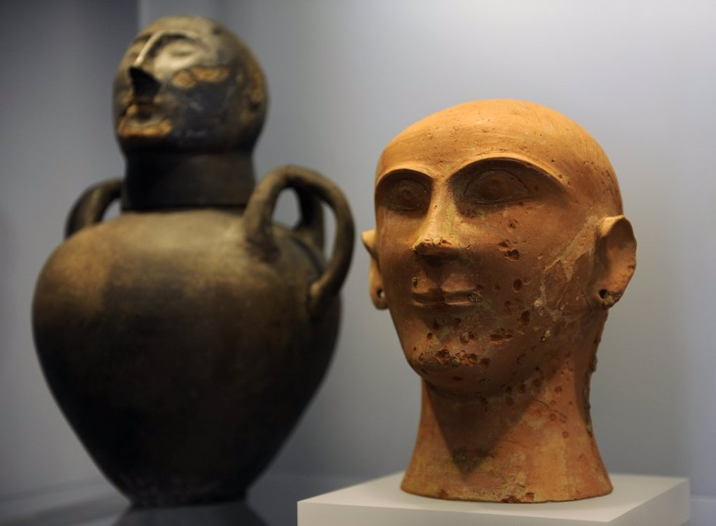 Stock Photo: 4409-64528 Etruscan Art. Italy. In honour of the ancestors. Symbolic faces were the focus and memorials held at the graveside. Symbolised Urns-face. Ny Carlsberg Glyptotek. Copenhage. Denmark..