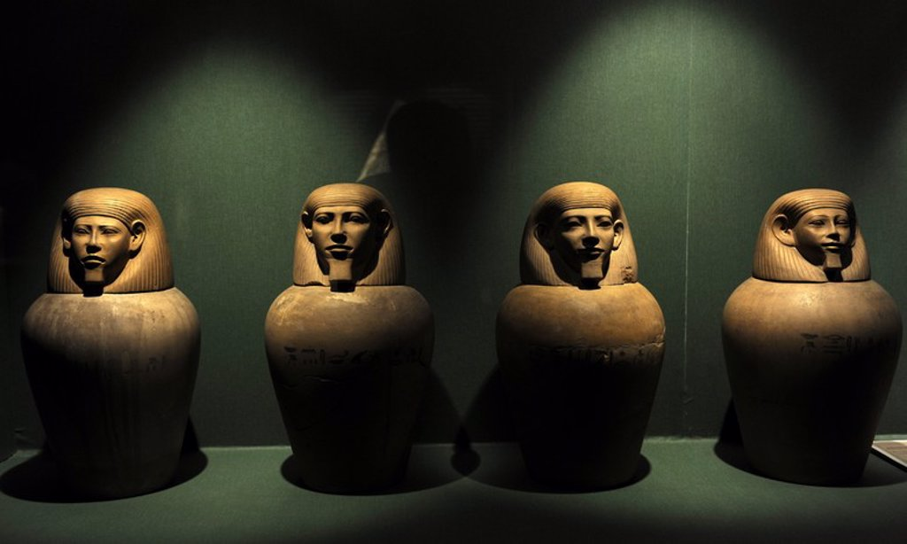 Canopic jars for the deceased's liver, lungs, stomach and intestines. Tomb 116. Cemetery A. Riqqeh, Egypt. C.1950-1800 BC. Middle Kingdom. Limestone. Ny Carlsberg Glyptotek Museum. Copenhagen. Denmark. : Stock Photo