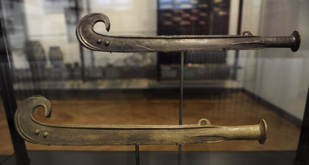 Stock Photo: 4409-72520 Curved swords sacrificed in a bog. C. 1550 BC. Bronze Age. Made in Scandinavia. From Rorby, western Zealand. National Museum of Denmark. Copenhagen. Denmark.