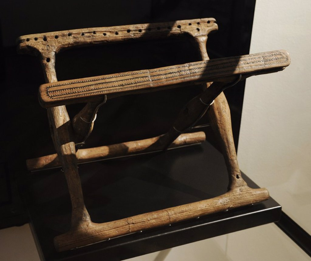 Folding chair in ash wood. Second half of 1400 BC. Bronze Age. Guldhoj barrow, Southern Jutland. National Museum of Denmark. Copenhagen. Denmark. : Stock Photo