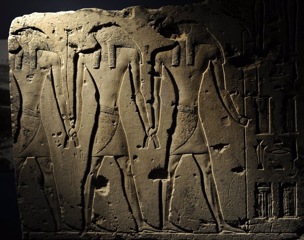 Relief depicting a falcon-headed gods, regarded as the original kings of Buto, mythical capital of Lower Egypt in the Nile Delta. Probably part of a temple wall. Memphis. Limestone. 26th Dynasty. Late Period. 664-525 BC. Ny Carlsberg Glyptotek Museum. Copenhagen. Denmark. : Stock Photo