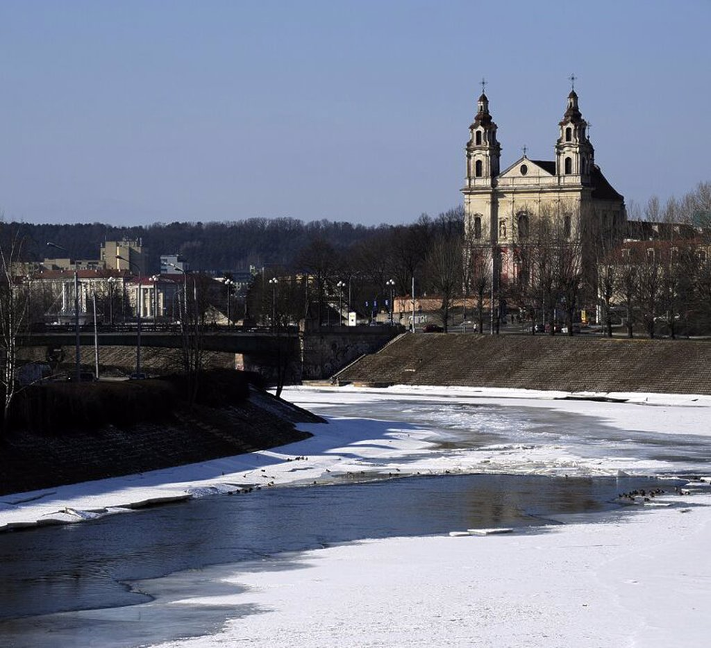 Stock Photo: 4409-72755 Lithuania. Vilnius. Frozen waters of the Neris river. At background, the Church of Saint Raphael the Archangel. 18th century.