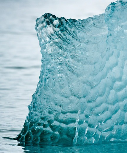 Patterns in blue iceberg off Spitsbergen, Svalbard Islands, Norway : Stock Photo