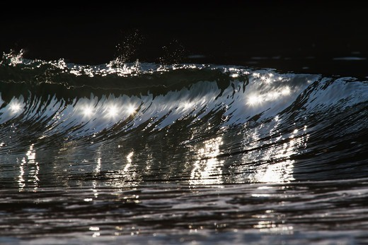 Stock Photo: 4411-4611 Wave Breaking With Sparkles In Silver Light,El Morro Bay, Laguna Beach, California, USA