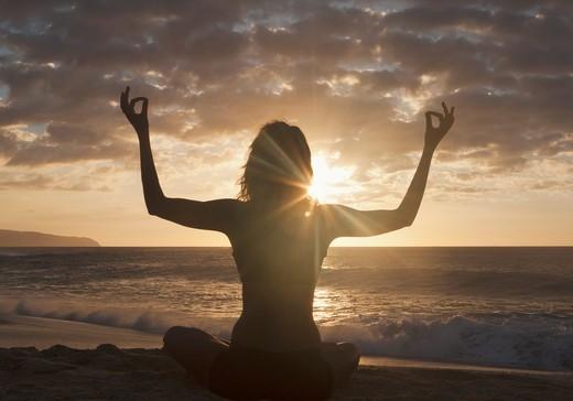 Hawaii, USA,Silhouette Of Woman Meditating On Beach : Stock Photo