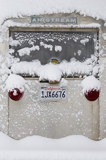 Missouri River, Montana, USA,vintage airstream covered in fresh snow : Stock Photo