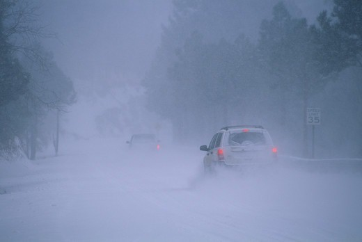 Stock Photo: 4412-1023 USA, Arizona, Blizzard striking mountains, making for hazardous winter driving