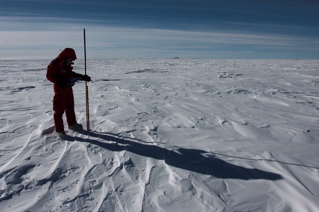 Glaiologue measuring snowfall Concordia  Antarctic : Stock Photo