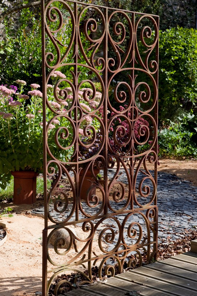 Stock Photo: 4413-137698 Wrought iron gate in an organic kitchen garden