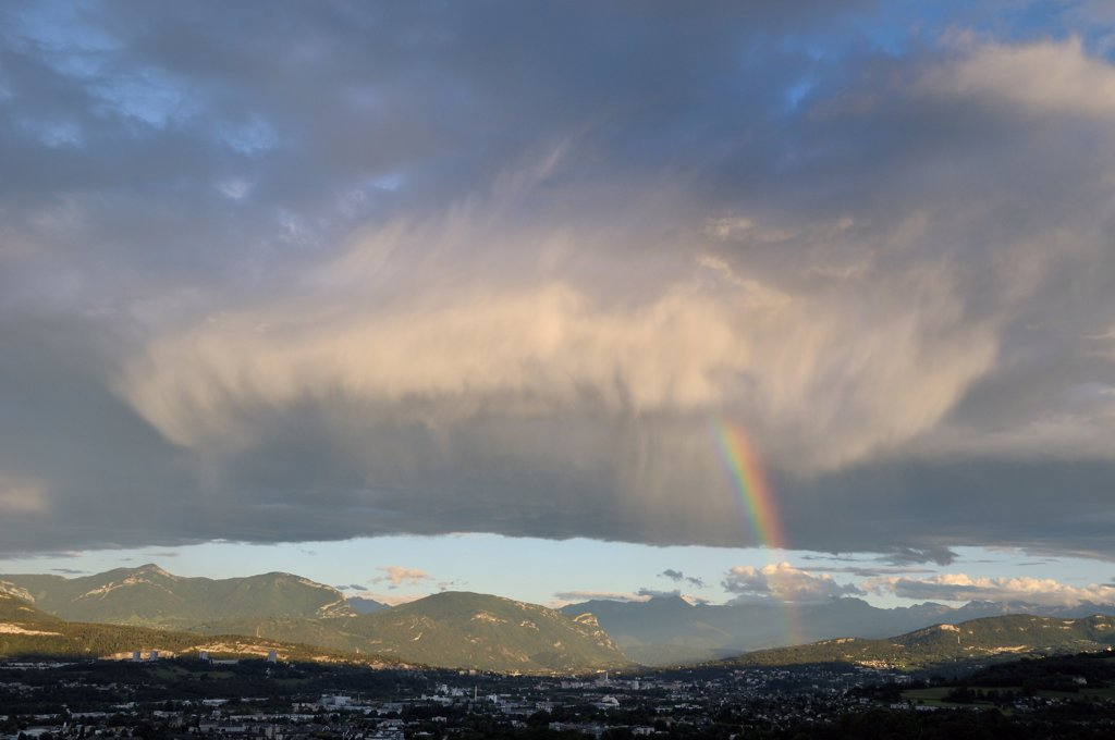 Stock Photo: 4413-171200 Cumulus clouds and rain under rainbow sky above Chambéry
