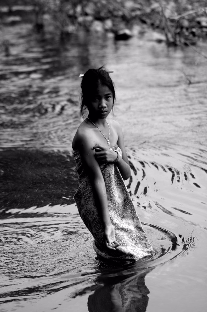 Stock Photo: 4413-177834 Young girl doing her toilet in the Mekong River Cambodia
