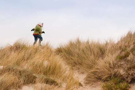 Noémie explores the Marquenterre dunes in the Somme Bay : Stock Photo