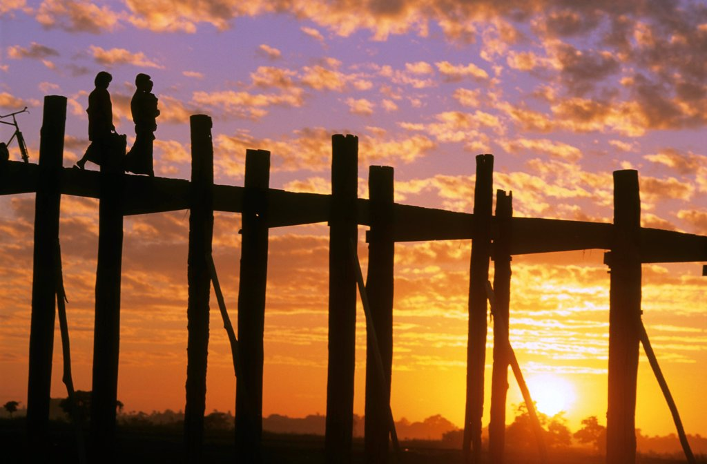 Persons on U Bein teck bridge at sunset Burma : Stock Photo