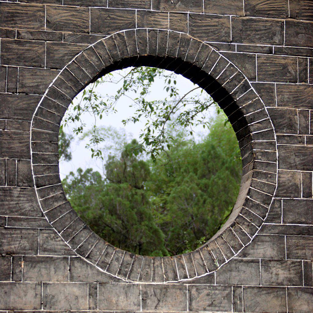 Stock Photo: 4413-21258 Fenestrate in a wall of farmyard Jianshui Yunnan China