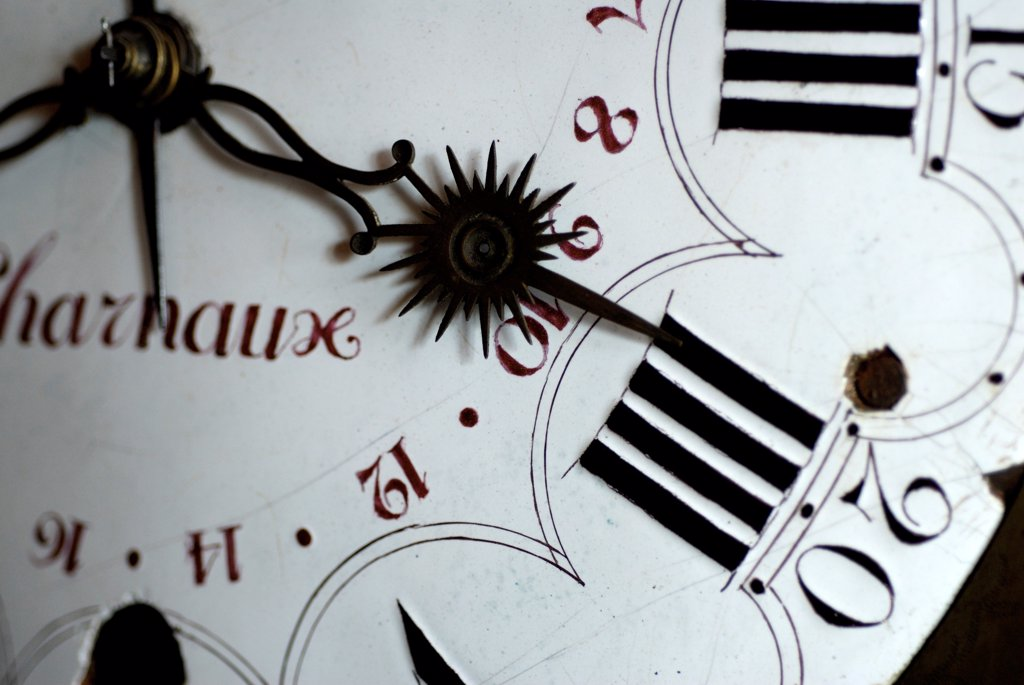 Stock Photo: 4413-2589 Spires and dial of an old clock