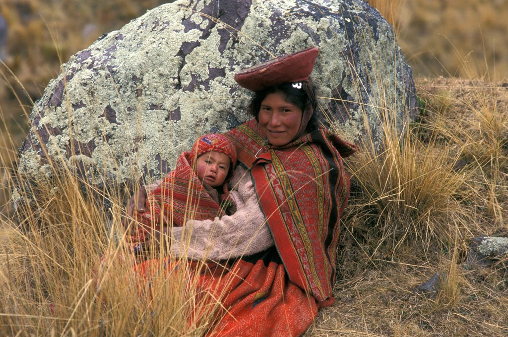 Stock Photo: 4413-28051 Woman in traditional clothe sitting with her child Peru