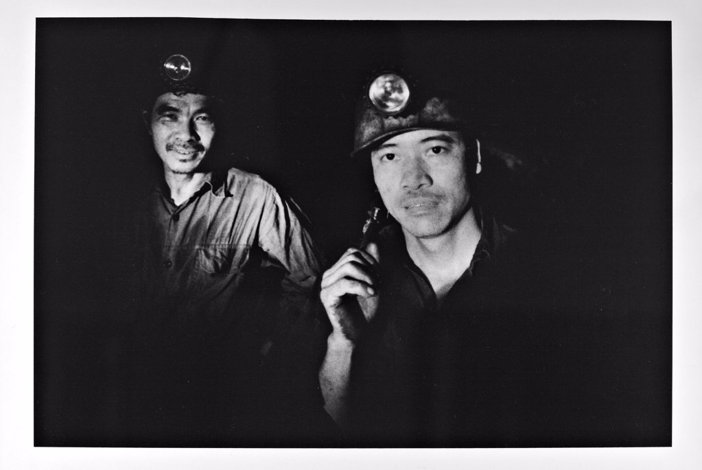 Stock Photo: 4413-29536 Portrait of helmeted miners at the bottom of the mine Vietnam