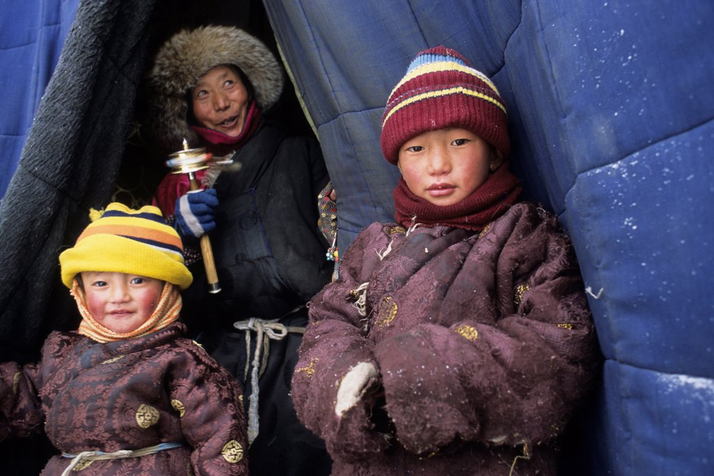 Tibetan children at the entry of a store Xiewu Kham area : Stock Photo