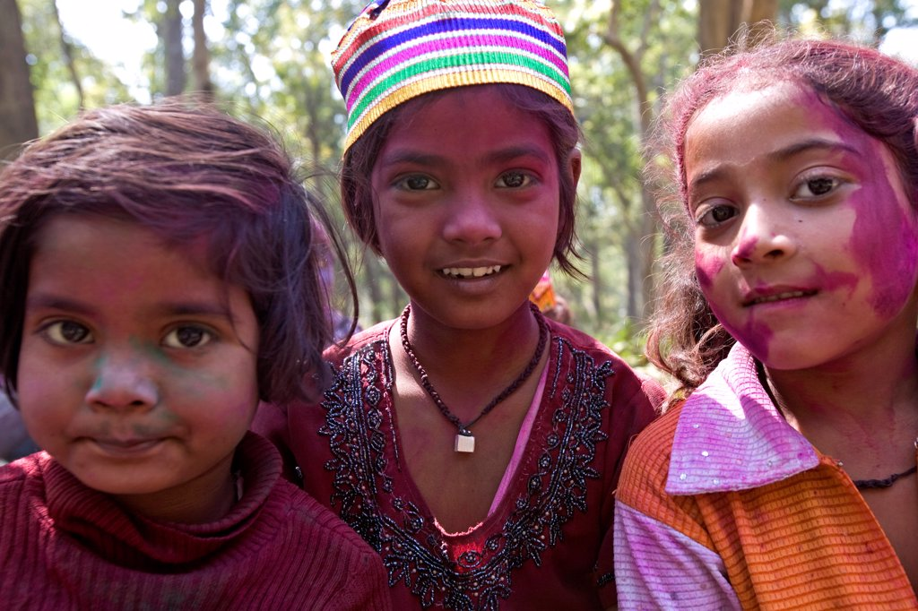 Stock Photo: 4413-38382 Children with colourful face at a holy festival India