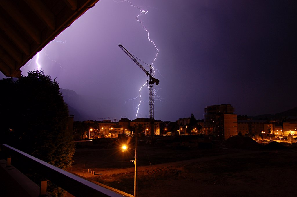 Stock Photo: 4413-43208 Lightnings flash on the city of Annecy during a night storm