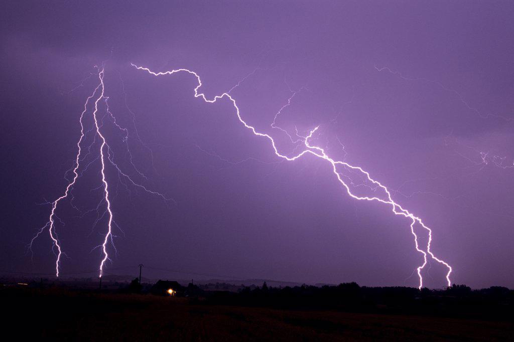 Lightning strikes at night in summer Allier France : Stock Photo