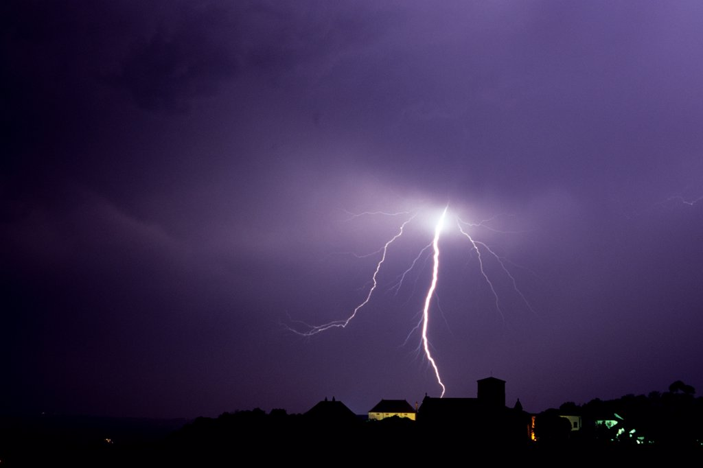 Stock Photo: 4413-54142 Staccato lightning strike behind a village France