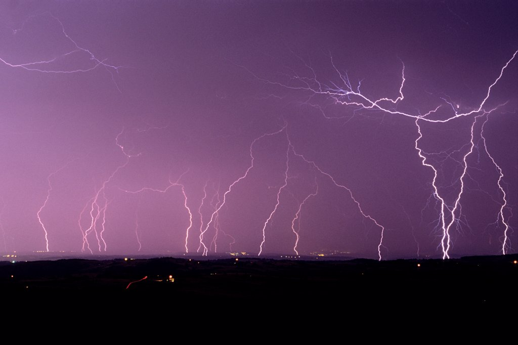 Multiple lightning strikes on the Roanne Plain France : Stock Photo
