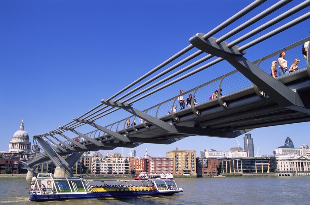 Low angle view of a footbridge across a river, Millennium Bridge, London, England : Stock Photo