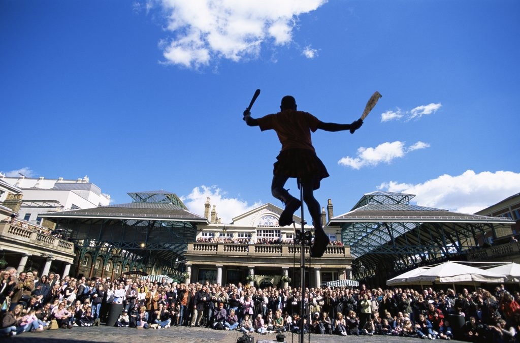 Stock Photo: 442-10194 Silhouette of a person unicycling, Covent Garden, London, England