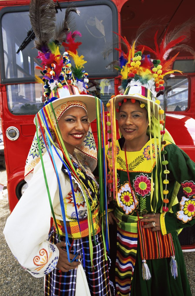 Stock Photo: 442-10256 Two mid adult women in traditional Bolivian costume in a parade, Carnaval Del Pueblo, Southwark, London, England