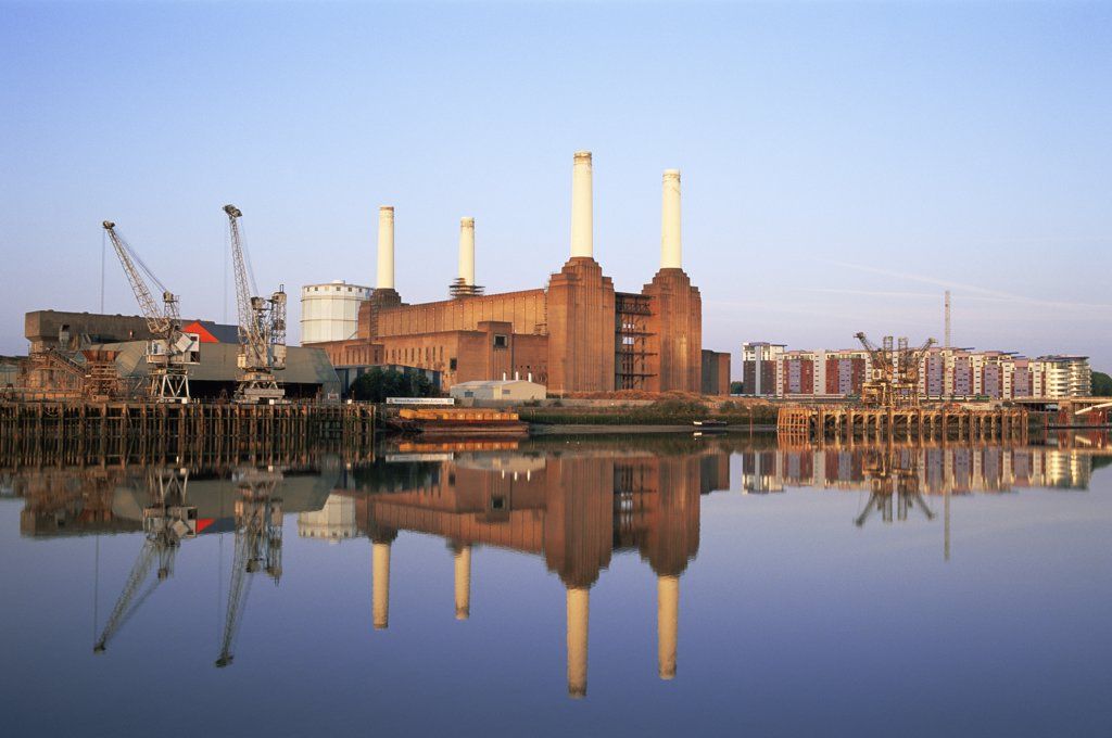 Reflection of buildings in water, Battersea Power Station, Battersea, London, England : Stock Photo