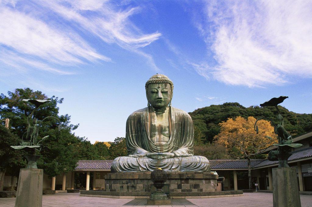 Buddha in front of a building, Daibutsu (Great Buddha), Kamakura, Tokyo, Japan : Stock Photo